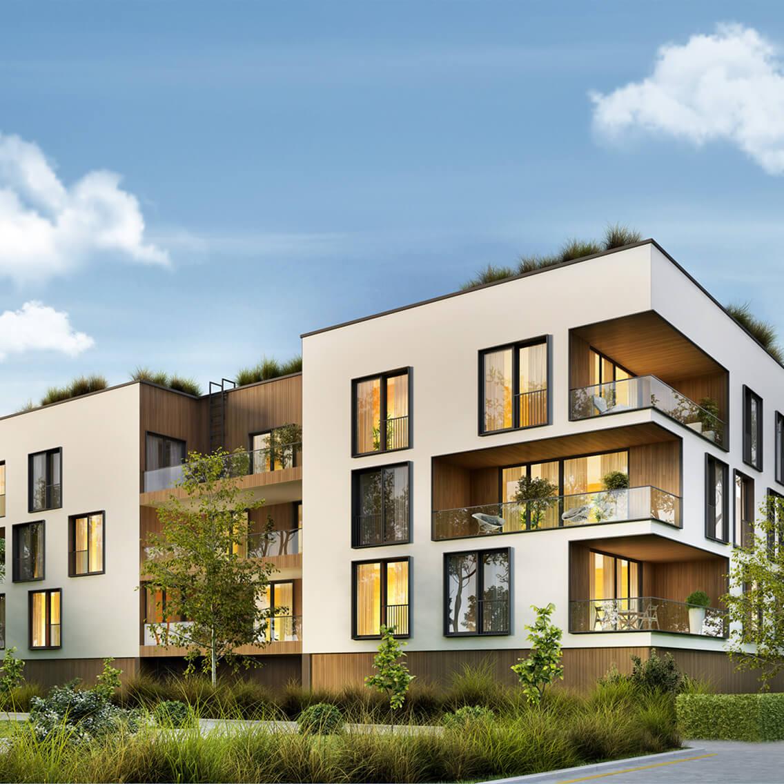Monteuer von Hümmer Elektrotechnik mit Ladesäule vor Mehrfamilienhäusern